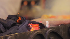 Street food fest. Burning coal smoldering in brazier. Traditional cuisine, bbq - stock footage