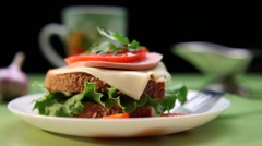 Sandwich with tomato, ham, cheese and salad Stock Footage