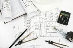 Architecture plan and rolls of blueprints Stock Photos