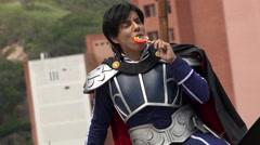 Cosplay Prince Eating Lollipop Stock Footage