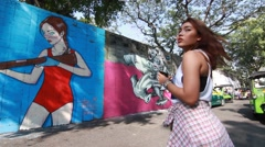 View of street art on the wall in a Soi (lane) of Bangruk area of Bangkok - stock footage