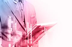 Double exposure of Architect or Business Man use Mobile Tablet with Construct Stock Photos