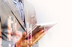 Double exposure of Architect or Business Man use Mobile Tablet with Construct - stock photo