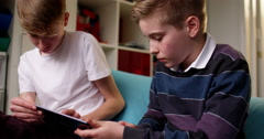 Two teenage boys having fun while using digital tablet Stock Footage
