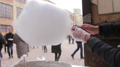 Street saleswoman making candy floss at the main square. Cool weekend. Open air Stock Footage