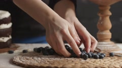 Blueberry Cake Arranged on a Wooden Table Stock Footage