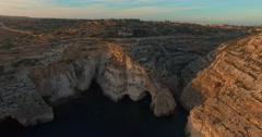 Aerial shot - Flying over Cliffs during Sunset Stock Footage