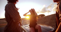 Teenage boho friends embraging and laughing at sunset Stock Footage