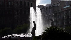 Placa Catalunya fountain and sculpture silhouette, high contrast shot, back lit Stock Footage
