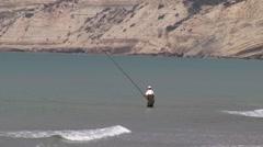 Cyprus fisherman angler in Mediterranean sea, zoom wide Stock Footage