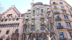 Casa Batllo facade, tilt up and down, few tourists in front of famous building Stock Footage