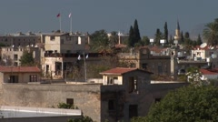 Cyprus Green Line looking north, Turkish and Greek Cypriot flags Stock Footage