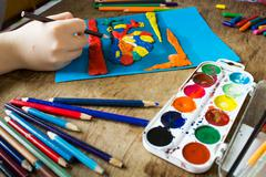 child is engaged in creativity - stock photo
