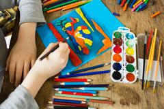 Child is engaged in creativity Stock Photos