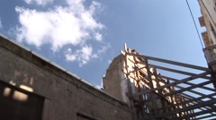 Cyprus Green Line UN buffer zone - tilt down from destroyed facade Stock Footage