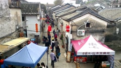 People visiting an old traditional Chinese village in New Year holidays - stock footage