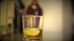 Putting Date rape drug in a drink Stock Footage