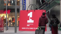 Liverpool one unidentified shoppers moving around a giant handbag time lapse Stock Footage