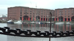 Albert docks in Liverpool, focus pull on chain in foreground Stock Footage