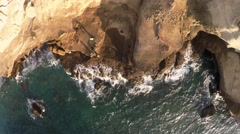 AERIAL: Abstract view of coastline, waves hitting the coast Stock Footage