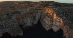 Aerial shot looking at European Cliffs during Sunset Stock Footage
