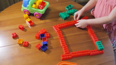 Little girl playing in constructor Stock Footage