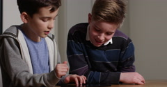 4k, Friends busy playing online games on a tablet. - stock footage