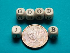 Job Search Concept. Coins and wooden block with message - stock photo