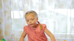 Portrait of a little girl playing with toy blocks, vertical pan Stock Footage