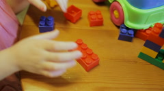 Сlose-up of a child's hand playing in constructor - stock footage