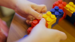 Сlose-up of a child's hand playing in constructor Stock Footage