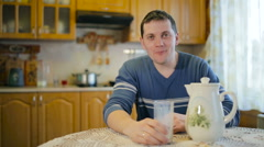 Portrait of a man drinking milk. - stock footage