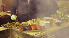 Gallant cook dressed in a suit cooking outdoors. Unordinary street food seller - stock footage