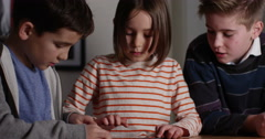 4k, Elementary school children using a digital tablet while sitting in class. Stock Footage