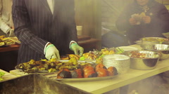 Unordinary cook in a suit preparing and selling meals. Street food festival Stock Footage