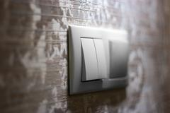 Light switch on the wall selective focus - stock photo
