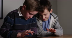4k, Teenage brothers play online game on a digital tablet. Stock Footage