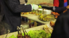 Stock Video Footage of Tasty and appetizing barbecue at street food festival. Gallant seller in a suit