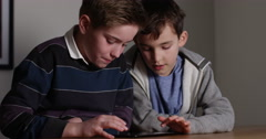 4k,Two friends using a digital tablet at home.  Stock Footage