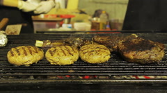 Stock Video Footage of Fatty grilled meat, barbecue. Unhealthy food at street food festival. Obesity