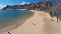 Tourists having fun at the Las Teresitas beach in Tenerife. Aerial video. Stock Footage