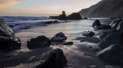 Ocean wave hitting the rocks at mistic beach - time lapse video Stock Footage
