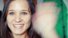 Happy attractive young woman having a video chat. Looking directly at camera Stock Footage