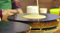 Street vendor cooking delicious pancakes for sale. Open-air food festival Stock Footage