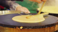 Skilled street cook making pancakes at open-air food festival. Appetizing meal Stock Footage