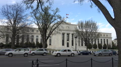 Wide push in includes flags, Federal Reserve building, Washington, DC Stock Footage
