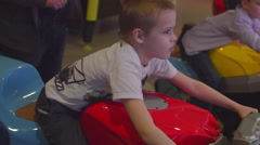 Boy Playing Slot Machines on a Motorcycle Stock Footage