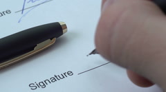 Signing official document with a blue ink pen Stock Footage