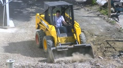 Front Loader construction crew removes dirt Stock Footage