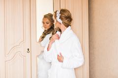 The bride in white bathrobe. Wedding preparations Stock Photos